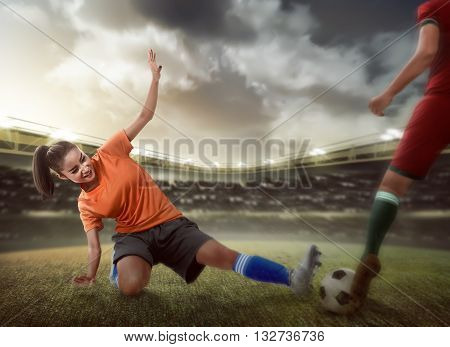 Football Player Tackling For The Ball