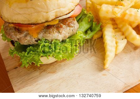 close-up hame made burger with copy space on wooden board