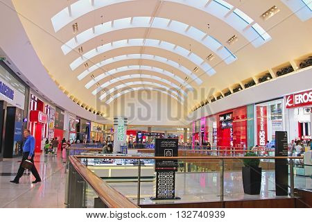 shopping center Dubai Mall inside view boutiques and people are shopping United Arab Emirates April 14 2014 soft focus