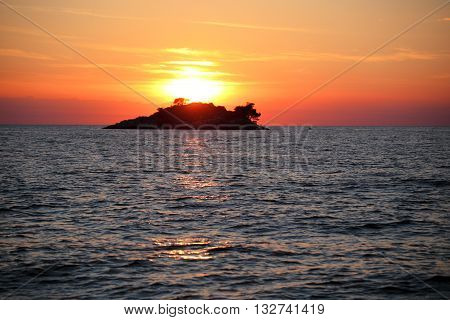 beautiful sundown on ocean with island in background