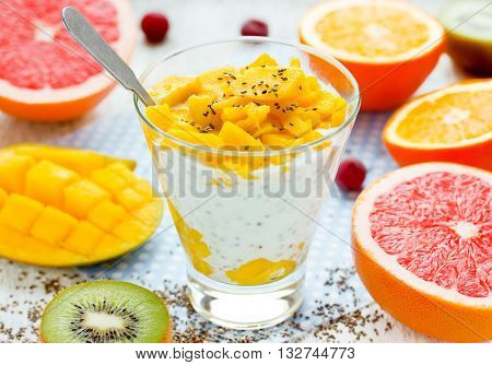 Mango chia pudding with fresh citrus fruit for breakfast dietary food concept selective focus
