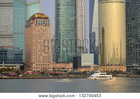 SHANGHAI, CHINA - MARCH 25: Pudong district view from The Bund waterfront area on March 25, 2016 in Shanghai, China. Pudong is a district of Shanghai, located east of the Huangpu River.
