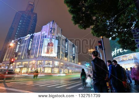 SHANGHAI CHINA - MARCH 18: People at Nanjing Road on March 18 2016 in Shanghai China. Nanjing Road is the main shopping street of Shanghai and is one of the world's busiest shopping streets.