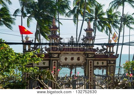 Beautiful Temple. Gate And The Flag Of Vietnam.mui Ne, Vietnam.