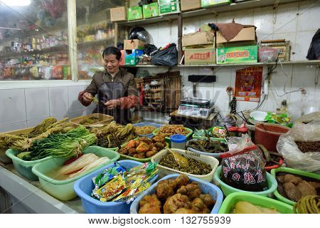 SHANGHAI CHINA - MARCH 19: Unidentified Chinese people trades traditional food in local market on March 19 2016 in Shanghai China. Shanghai is the largest Chinese city by population.