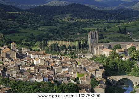 Village and Abbey of Lagrasse. St Mary is a Romanesque Benedictine abbey in the medieval village of Lagrasse whose origins date to the 7th century.