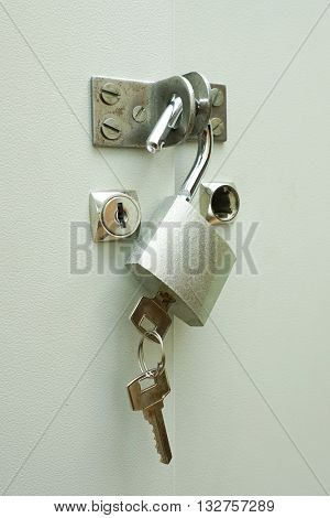 The metal lock with key on a door , vertical image.
