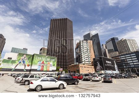 DALLAS USA - APR 7: Parking lot with big commercials billboards on buildings downtown in Dallas. April 7 2016 Dallas Texas United States