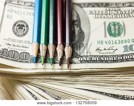 Education Has A Price, The Money Allocated For Education, Investment In Knowledge, Dollars And Pens,