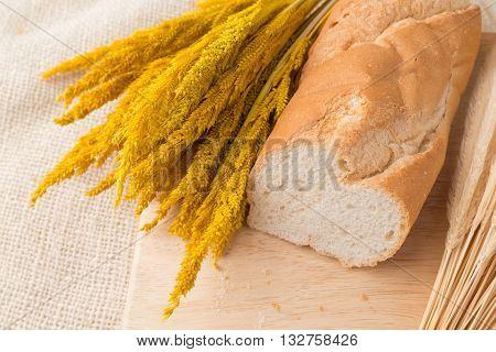 Sharp Sliced Of French Bread Baguettes On Bread Board