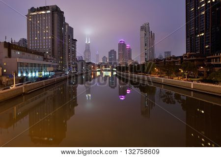SHANGHAI CHINA - MARCH 19: Suzhou Creek on March 19 2016 in Shanghai China. Suzhou Creek (or Soochow Creek) also called Wusong River is a river that passes through the Shanghai city centre.