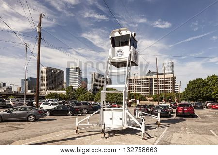 DALLAS USA - APR 7: Police Observation Tower in a parking lot in Dallas downtown. April 7 2016 in Dallas Texas United States