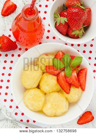 Lazy dumplings with cottage cheese and strawberries tasty and healthy summer dish with cottage cheese and fresh berries