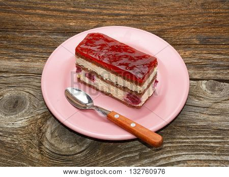 cherry cheesecake on wooden background in studio