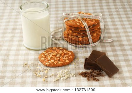 chip cookie with glass of milk and chocolate