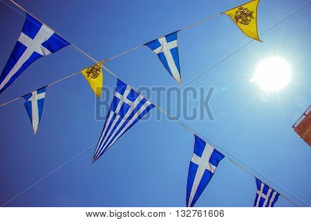 Triangular Greek Sea Flags On Blue Sky, Sun