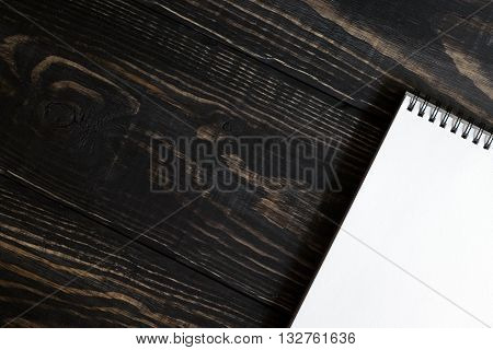 White Sketchbooks On A Wooden Background