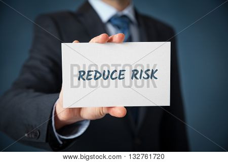 Businessman investor coach plan to reduce risk. Risk management concept.