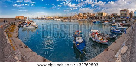 Panorama of Old harbour with fishing boats and marina in the summer sunny morning, Heraklion, Crete, Greece.