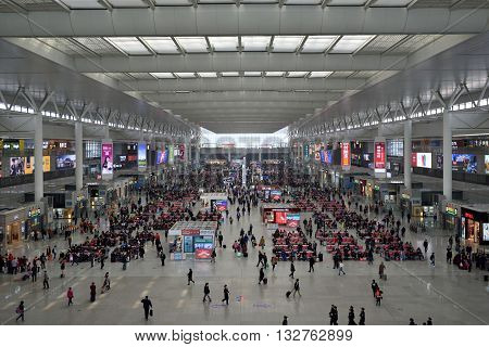 SHANGHAI CHINA - MARCH 21 2016: Passengers waiting at Hongqiao Railway Station on March 21 2016 in Shanghai China. Hongqiao Railway Station is one of the three major railway stations in Shanghai.