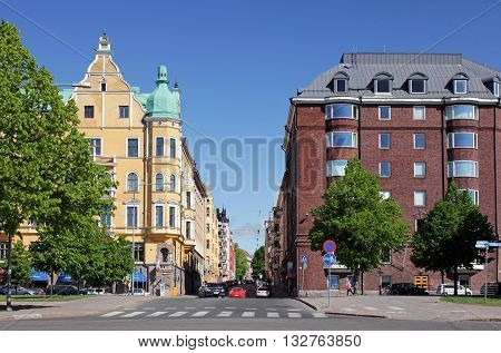 HELSINKI FINLAND - MAY 27 2016: Neitsytpolku street in famous Ullanlinna district of Helsinki at sunny spring day. Crossroad of Merikatu Neitsytpolku and Puistokatu streets May 27 2016.