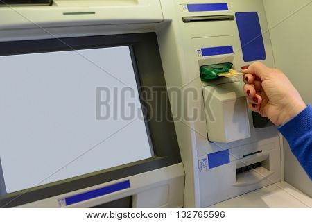 image of withdrawing money from ATMs close-up