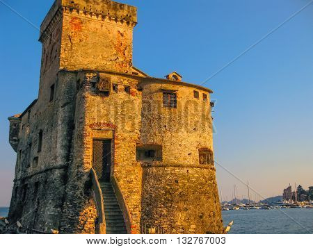 The medieval castle at sunset in Rapallo, famous Italian tourist resort close to Portofino and Santa Margherita Ligure in the province of Genoa, Ligury, Italy.