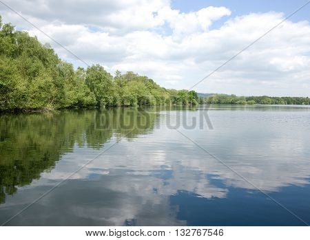 Reflections of clouds in a calm lake