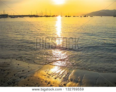 Sunset over the sea in the famous beach of the Bay of Fairy Tales in Sestri Levante, Province of Genoa in Liguria, Italy.