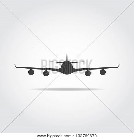 Commercial big plane from front with long wings and four jet engenies.