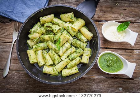 Italian pasta with pesto sauce on pan
