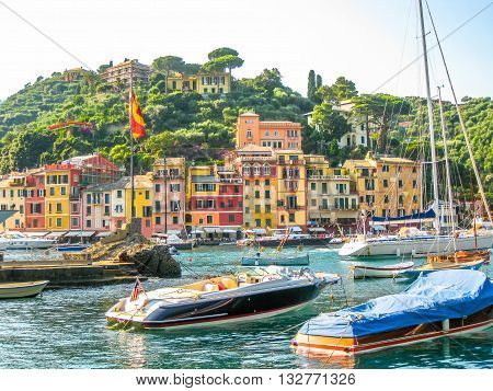 Close up of the picturesque harbor and the luxurious yachts of Portofino, in the famous vacation resort and italian fishing village, provinces Genoa, Italy.