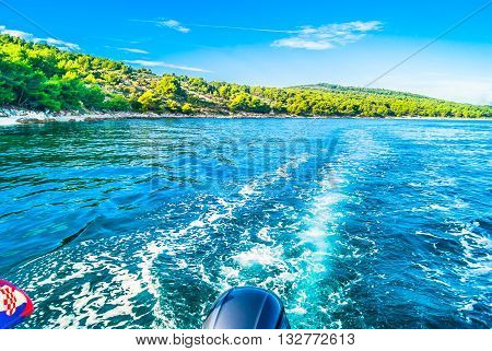 Touristic destination Croatia - coastline view from boat in summer time, Adriatic sea.