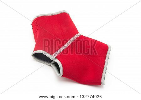 close up of red ankle support on white background