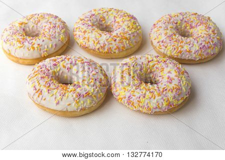 Donuts for tea. Tasty food cakes. Classic cakes: fried doughnuts glazed with caramel. Nutritious dish that promotes obesity.