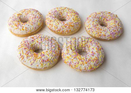 Tasty doughnut for tea. Donuts stacked slide. Food cakes delicious classic: fried doughnuts glazed with caramel. Nutritious dish that promotes obesity.