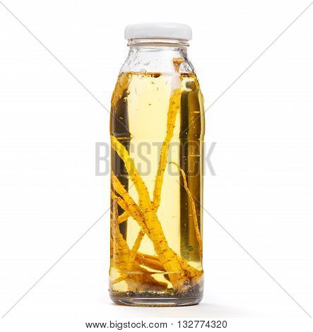 Exotic sunflower oil bottle with parsley root and spices. Object on white background