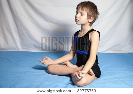 The young boy who is practices yoga