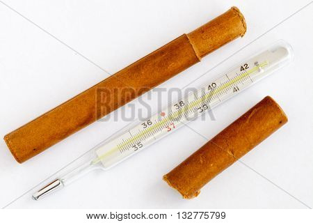 Medical mercury thermometer with a box on the white