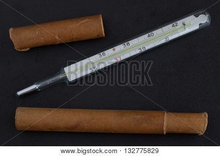 Medical mercury thermometer with a box on the black
