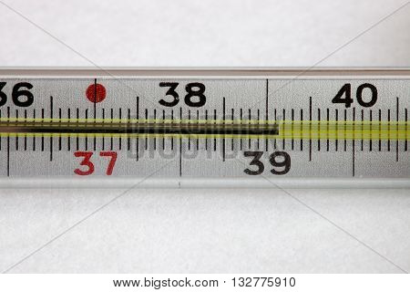 Medical mercury thermometer on the white background