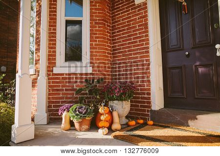 Pumpkin decoration for Thanksgiven near door outside a house