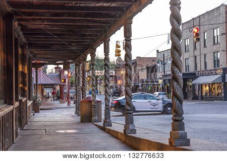 FORT WORTH TX USA - APR 6: Street in the Fort Worth Stockyards district illuminated at dusk. April 6 2016 in Fort Worth Texas USA