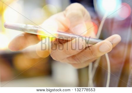 communication technology concept, close up image of people using smart phone, Multiple exposure of smart phone and Bokeh