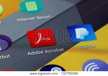 SARANSK, RUSSIA - JUNE 04, 2016:  A smartphone screen shows Adobe Acrobat icon on the screen. Selective focus.