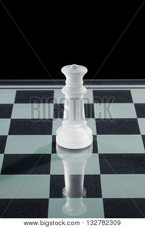 Glass Chess Queen Standing On Chess Board