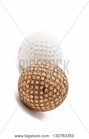 Tilt Image Of A White And A Brown Golf Ball