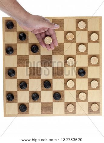 White Checker Piece Hold By A Hand On The Game Board