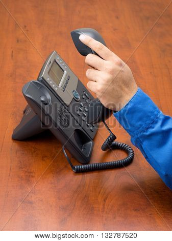 Close Up Of Human Hand Holding Telephone Receiver