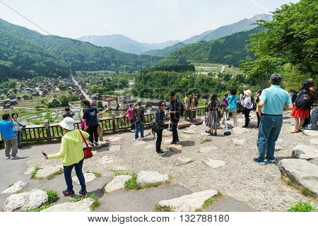 Gifu Japan - May 14 2016: Tourists visit viewpoint of old village Shirakawa-go Japan. Shirakawa is one of most popular attractions in Japan listed as UNESCO World Heritage Site since 1995